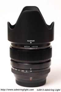 The hood included with the lens is a large petal-type design