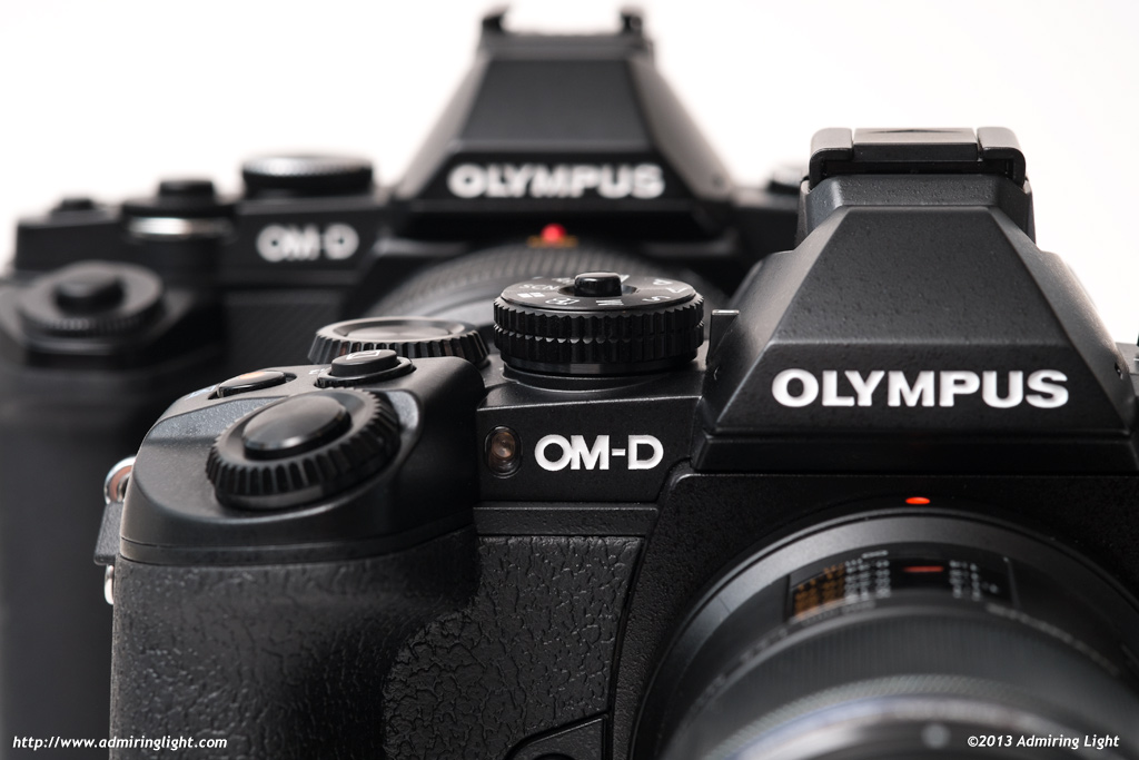 OM-D Generations, the new E-M1 (foreground) and the E-M5
