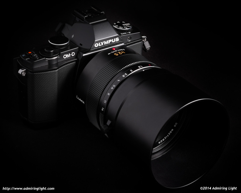 The Panasonic Leica 42.5mm f/1.2 Nocticron on the Olympus OM-D E-M5, with the included metal hood