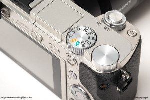 The top controls of the a6000, with the Mode dial, the main dial, shutter button and C1 button