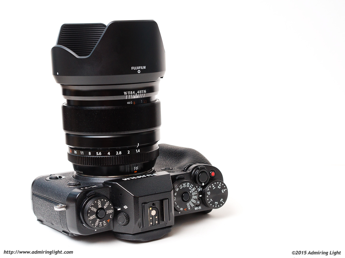 The 16mm f/1.4 with its included hood