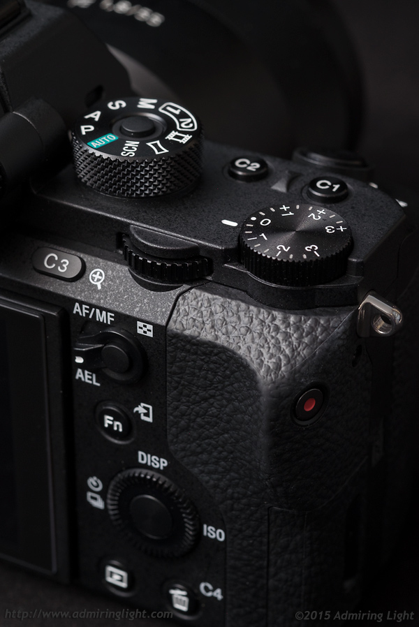 The top and rear controls are the same as those on the A7 II, save for the mode dial lock