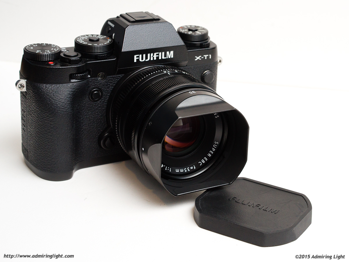 The XF 35mm has a non-reversible pinched hood with rubber cap