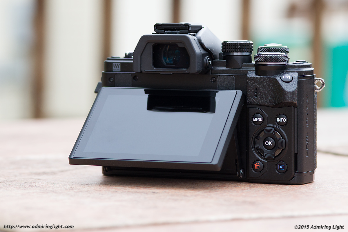 The rear screen of the E-M10 Mark II tilts, but isn't fully articulated