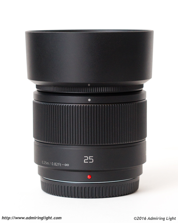 The Panasonic 25mm f/1.7 with the included lens hood
