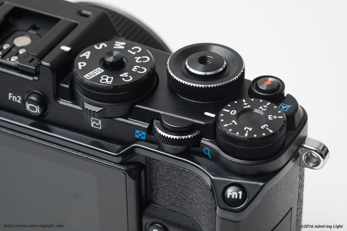 The three major control dials, the mode dial and the curves lever all sit on the top and rear of the camera