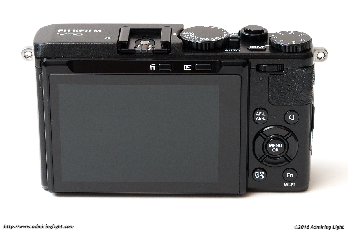 The rear of the Fuji X70 looks much like the back of other Fuji cameras.