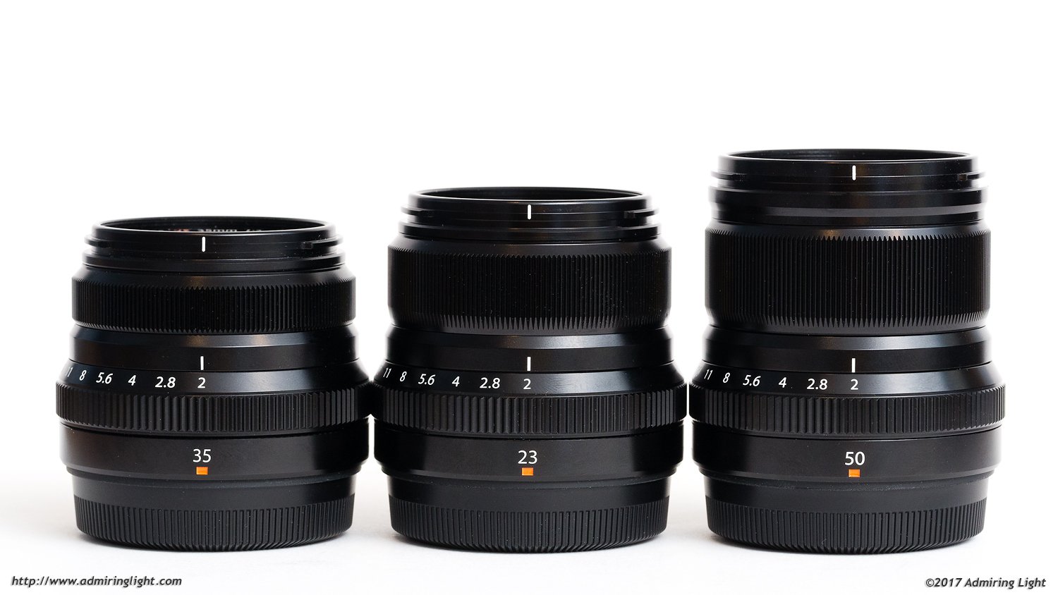 The lenses of Fuji's compact f/2 prime lineup: 35mm f/2, 23mm f/2 and the new 50mm f/2